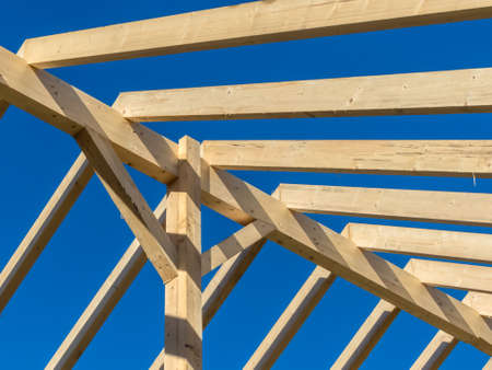 subsidy: in a house, a new roof is built on a construction site. carrier wooden roof.