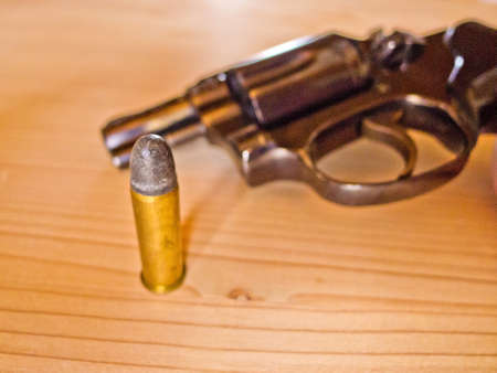 a revolver with a single cartridge. photo icon for russian roulette.