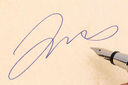 notieren: a signature and a fountain pen on yellow paper. photo icon for contract testament and graphology