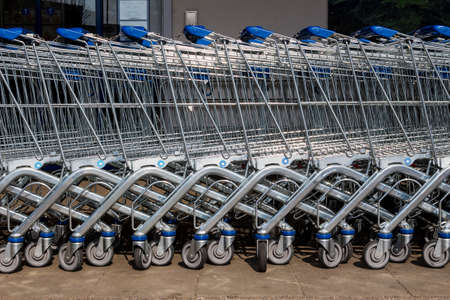 grocers: in front of a supermarket shopping carts are ready for customers Stock Photo
