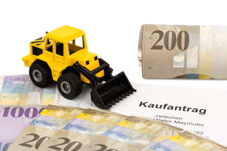 a purchase contract for new excavator. invest in new vehicles brings cost advantages. with swiss francs photo