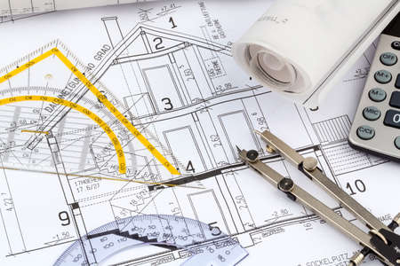 passive: an architects blueprint with a calculator. photo icon for financing and planning of a new house. Stock Photo