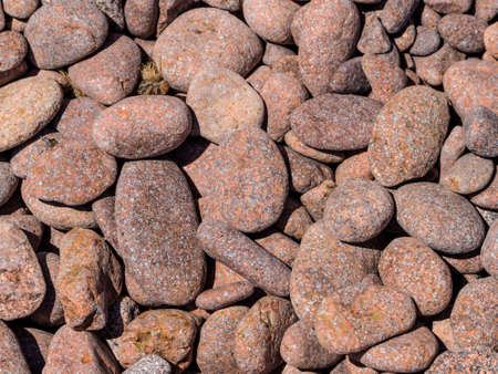 next to each other: stones lying on a beach next to each other. photo icon for eternity