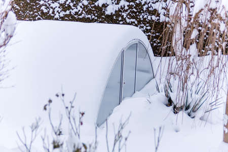 greenhouse in the snow, photo icon for the winter, frost protection and dormant