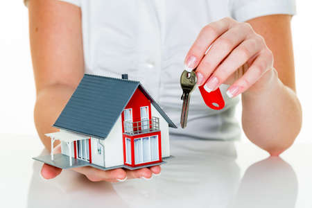 immobilien: an agent for property with a house and a key. successful leasing and home sales by real estate agents.
