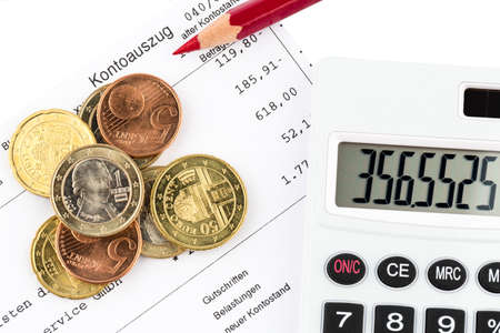overdraft: the bank statement and some coins of euro currency Stock Photo
