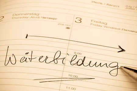 entered: an appointment is entered on a calendar training Stock Photo