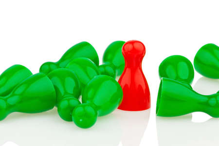 outsider: red and green pawns. bullying, loneliness and outsider in the team. Stock Photo