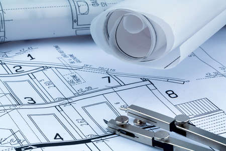 construction draftsman: an architects blueprint for the construction of a new house. symbolic photo for funding and planning of a new home.