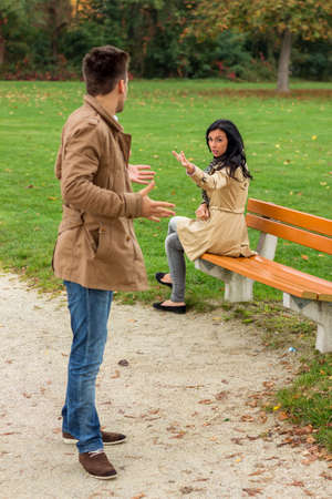 rejection sad: a young couple sitting on a park bench and fight Stock Photo