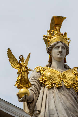 pallas: parliament in vienna, austria. seat of government. statue of pallas athena, goddess of weiheit.