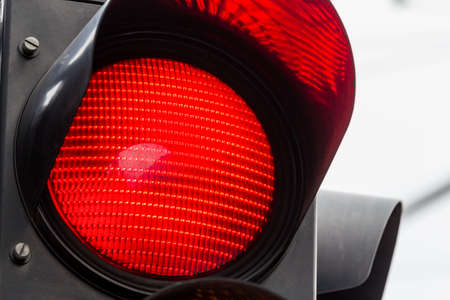 control panel lights: a traffic light shows red light. symbolic photo for maintenance, end.