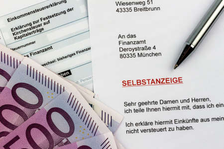 treaties: symbolic photo for a voluntary due to evasion of taxes at the tax office in germany