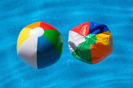 next to each other: two colorful plastic balls next to each other, symbolic photo for difference, change, aging