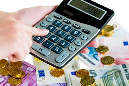 hand with calculator and money bills. symbolic photo for sales, profits, taxes and costing
