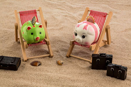 cheaper: a piggy bank is in a deck chair. symbolic photo for airline travel and expenses on vacation
