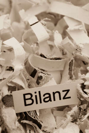 shredded paper for keyword balance, symbolic photo for data destruction, accounting, and economic analysis Stock Photo