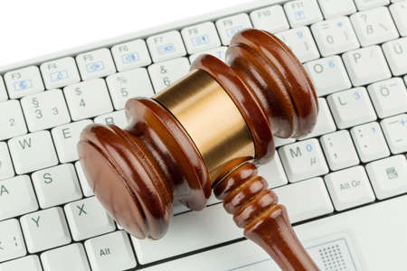 consumer rights: gavel on computer keyboard, symbolic photo for e-commerce and consumer protection Stock Photo
