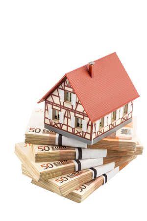 single familiy: half-timbered house on euro banknotes, symbolic photograph for home purchase, financing, building society Stock Photo
