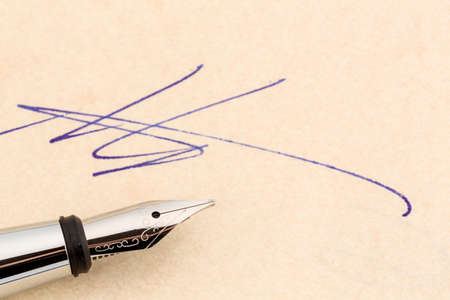 a contract or document shall be signed by hand with a fountain pen. Stock Photo