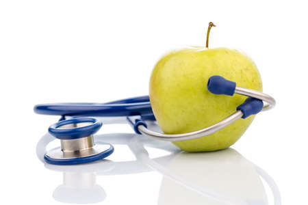 naturally: an apple and a stethoscope with a doctor. symbolic photo for healthy, vitamin-rich diet.