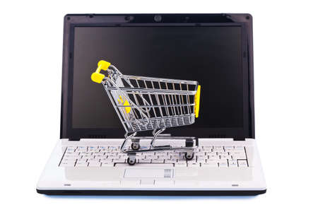 a shopping cart and a computer keyboard. photo icon online shopping