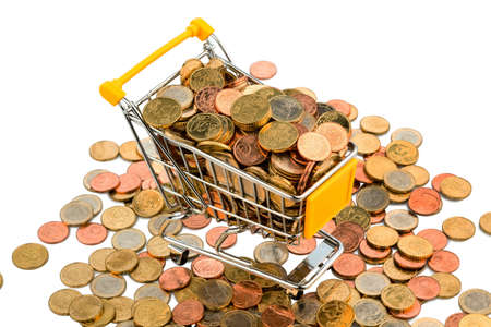 purchasing power: a shopping cart is full with euro coins, symbolic photo for purchasing power and consumption