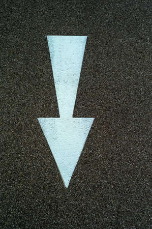 marked down: arrow direction as a marker on a bike path in linz, austria Stock Photo