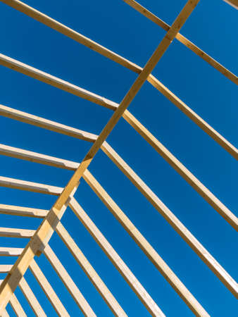 subsidy: in a house with a new roof is built on a construction site. carrier wooden roof.