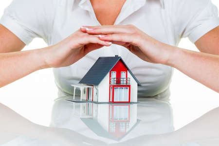 homeowners insurance: a woman protecting your home and home. good and reputable insurance financing calm. Stock Photo
