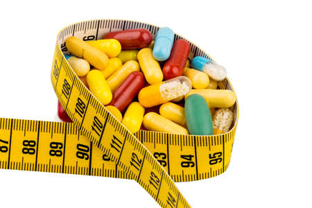 thinness: tablets and measuring tape, symbolic photo for appetite suppressant diet pills and thinness Stock Photo