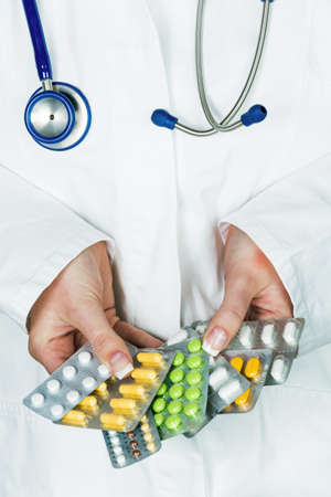 pracitioner: a young doctor prescribes medication. prescription pills are prescribed by a doctor. Stock Photo