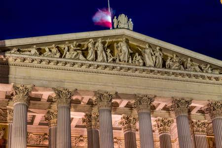 parliament in vienna, austria. seat of government. night scene photo