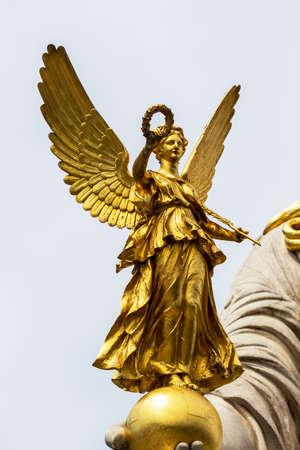parliament in vienna, austria. seat of government. statue of pallas athena, goddess of weiheit. photo