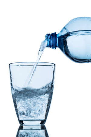 hydrology: from a water bottle water being poured into a glass