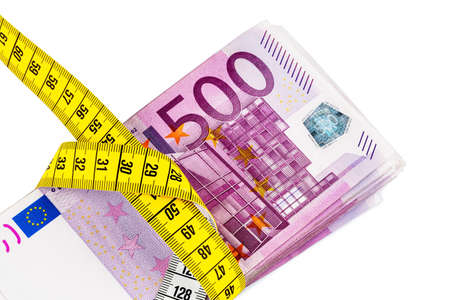 austerity: notes and tape measure, symbolic photo for austerity measures, fiscal consolidation and controlling Stock Photo