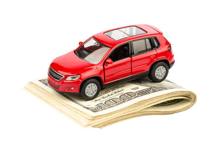 auto insurance: a car is on dollar bills. costs for the purchase of automobiles, gasoline, insurance and other car costs Stock Photo