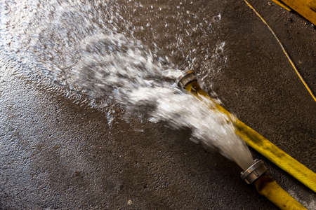 entered: fire brigade pumps a cellar, has entered the water Stock Photo