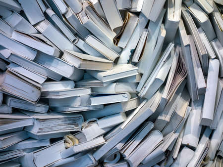 messed: many books are completely messed up on a pile
