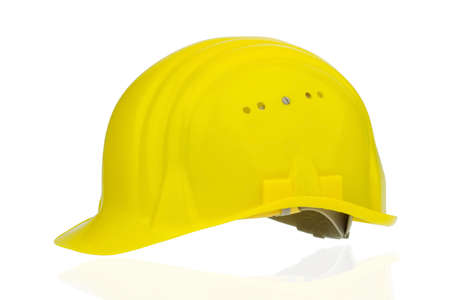 collective bargaining: yellow industrial safety helmet, icon photo of labor, occupational safety and accident prevention