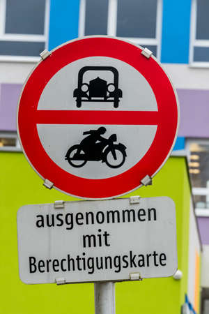 exceptions: prohibition sign for car and motorcycle, symbol of transport policy, noise protection, bureaucracy