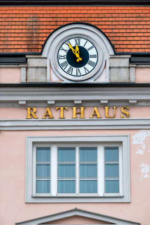 time deficit: clock at the town hall, the symbol of an empty treasury in municipalities and communities. 5vor12 for municipal budget Stock Photo