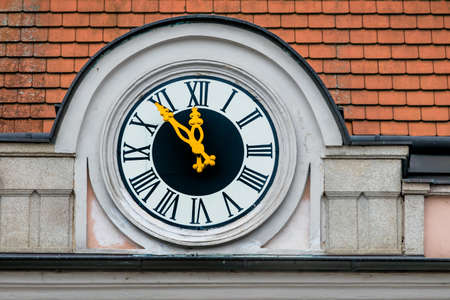 ultimatum: clock at the town hall, the symbol of an empty treasury in municipalities and communities. 5vor12 for municipal budget Stock Photo