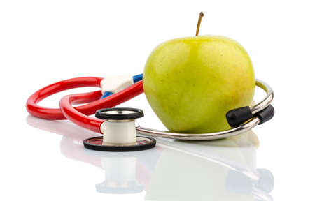 dietitian: an apple and a stethoscope with a doctor. symbolic photo for healthy, vitamin-rich diet.