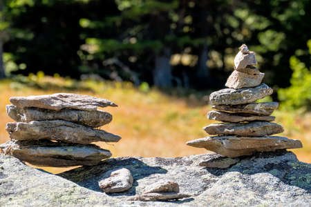 stacked stones, symbol for hiking, marking, orientation photo
