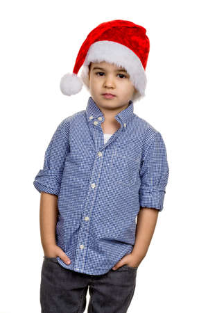 little boy with santa hat, symbol of christmas, self-confidence, transparency Stock Photo