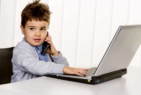 consumerist: little boy on a laptop, symbol of the internet, e-commerce, consumer behavior Stock Photo