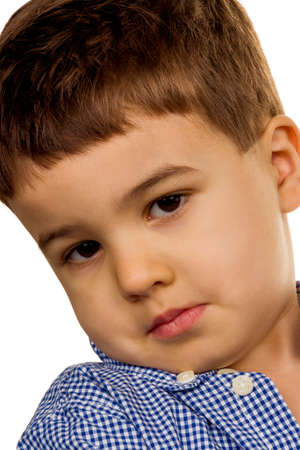 stubbornness: little boy looks defiant symbol of childhood, stubbornness, defiance