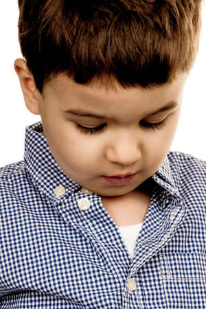shyness: portrait of a little boy, a symbol of childhood, insecurity, shyness