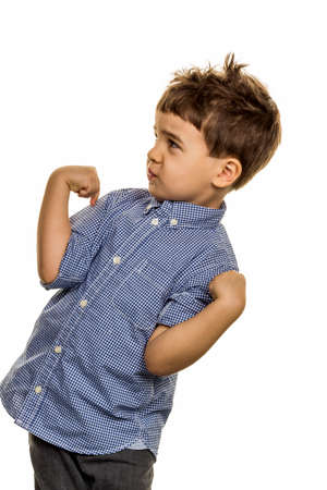 carelessness: little boy in pose, symbol of childhood, carelessness, mischievousness Stock Photo